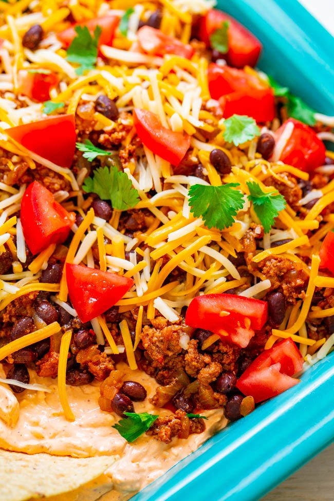 close up shot of dish containing taco dip with meat