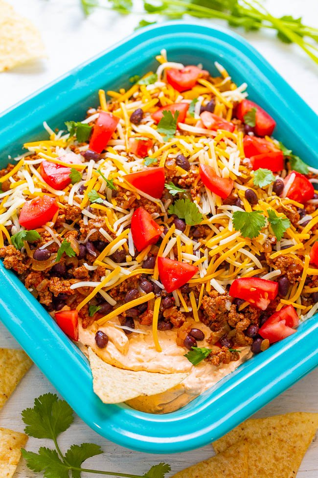 Overhead shot of layered taco dip in a baking dish
