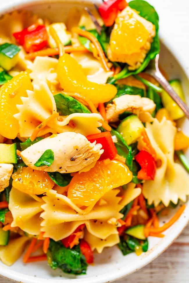 Mandarin Orange Chicken Pasta Salad - EASY, ready in 30 minutes, and packed with Asian-inspired flavors!! Juicy sesame chicken, pasta, and lots of healthy vegetables! PERFECT for potlucks, picnics, parties, and planned leftovers!!