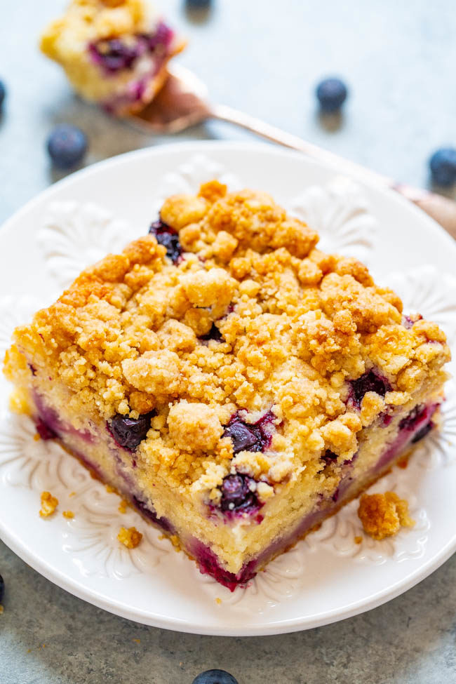 Slice of Blueberry Streusel Coffee Cake on white plate