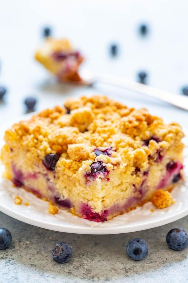 Blueberry Streusel Coffee Cake - An EASY, no-mixer cake studded with juicy blueberries and topped with big buttery streusel nuggets that are just SO GOOD!! Not overly sweet and PERFECT with a cup of coffee for breakfast, brunch, or a snack!!