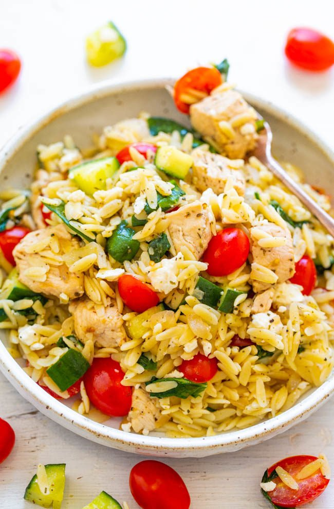A white bowl of Greek Lemon Chicken and Orzo Pasta Salad