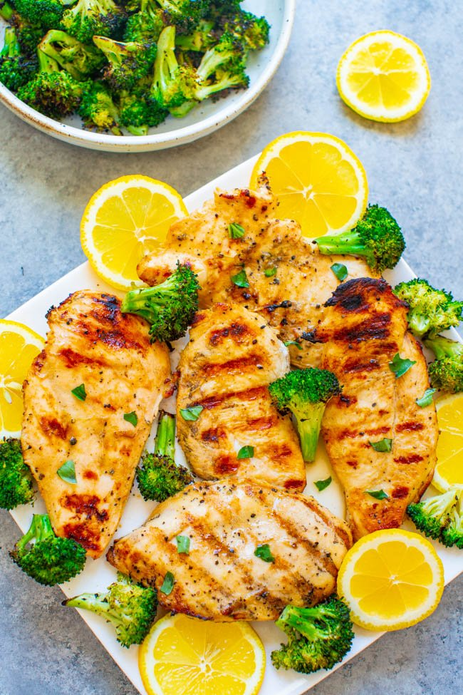 Grilled Lemon Chicken - EASY, ready in 10 minutes, and the chicken is so TENDER, juicy, and full of LEMON flavor!! With grilled broccoli on the side, this is a HEALTHY recipe perfect for swimsuit season that tastes AMAZING!!