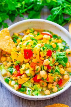 Mango Chickpea Salad - An EASY salad that's ready in 5 minutes, HEALTHY, and full of Mexican-inspired flavors!! Great as a meatless lunch, dinner side dish, or for picnics and potlucks!!
