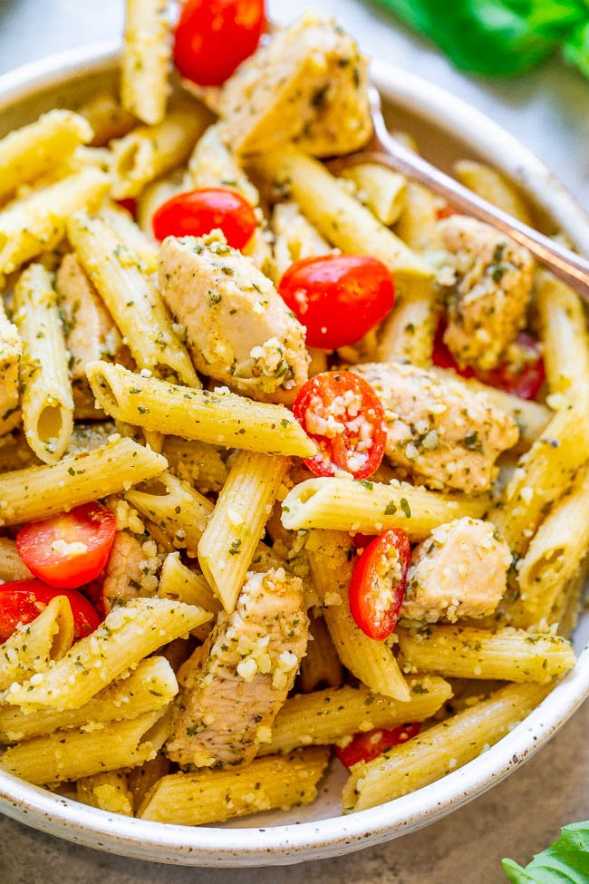 Pesto Parmesan Chicken and Pasta - EASY, ready in 20 minutes, and every piece of tender chicken and pasta is coated in fresh pesto sauce and parmesan cheese!! Great for easy weeknight dinners, planned leftovers, or for parties because it feeds a crowd!!