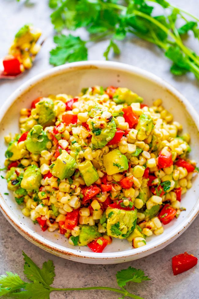 Grilled Corn and Avocado Salad - An EASY and HEALTHY salad that's ready in 10 minutes and you won't be able to stop eating it!! Juicy corn, creamy avocado, cilantro, and fresh lime juice is a FIESTA in your mouth!!