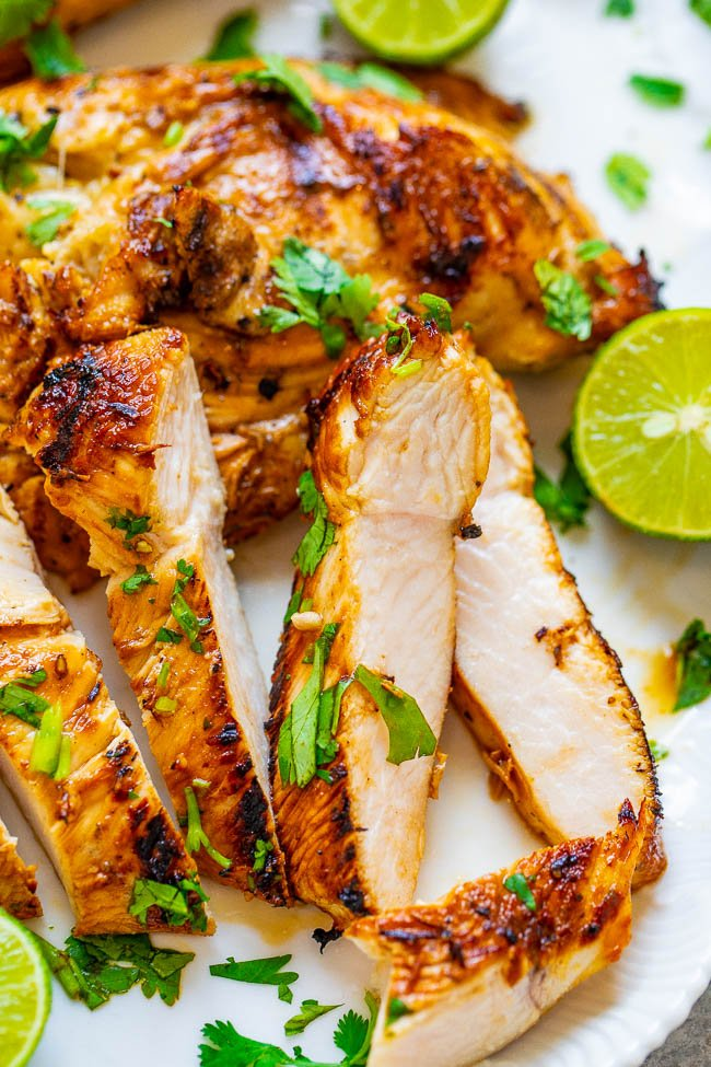Grilled Lime Cilantro Chicken - EASY, ready in 10 minutes, and the chicken is so TENDER, juicy, and full of Mexican-inspired flavor!! Put this HEALTHY chicken recipe on your summer menu rotation and it'll be a hit with everyone!!