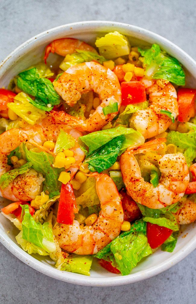Honey Lemon Shrimp and Corn Salad - Tender juicy shrimp nestled in a crunchy fresh salad and everything is coated in an IRRESISTIBLE honey lemon sauce!! An EASY and HEALTHY salad that's ready in 10 minutes!!