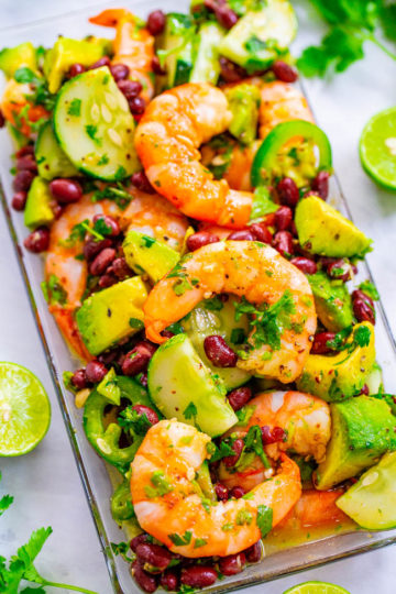 Lime Cilantro Shrimp and Black Bean Salad - Tender juicy shrimp, black beans, avocado, cilantro, and more coated in a lime sauce that's a FIESTA in your mouth!! An EASY and HEALTHY Mexican-inspired salad that's ready in 10 minutes!!