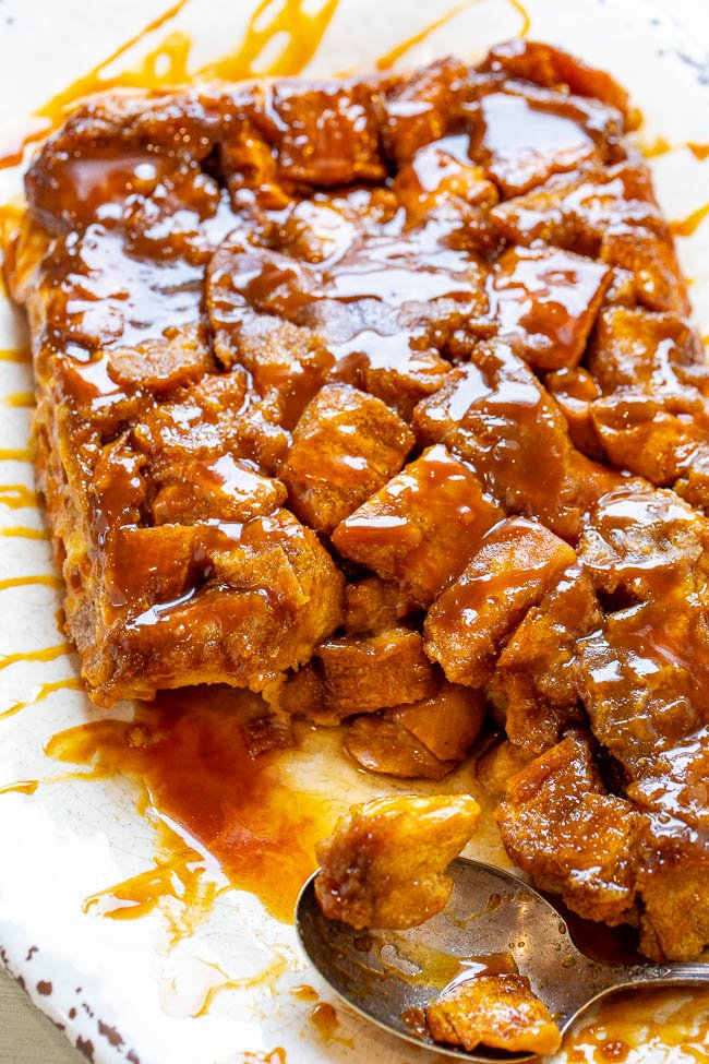 Overnight Caramel French Toast Casserole - EASY, soft, tender, and decadent French toast that's coated in caramel sauce!! Assemble it the night before and wake up to an amazing breakfast or brunch that everyone will ADORE!!