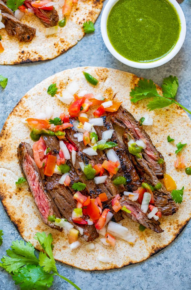 Carne Asada Tacos - EASY carne asada at home that rivals your favorite restaurant!! Tender juicy beef that's seasoned to perfection and topped with pico de gallo and salsa make these carne asada tacos INCREDIBLE!!