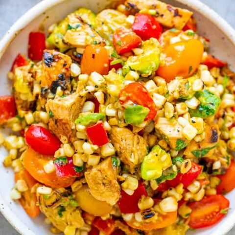 Grilled Chicken and Corn Salad - An EASY salad that's ready in 15 minutes and you won't be able to stop eating it!! Tender chicken, juicy corn, crisp bell peppers and tomatoes, creamy avocado, cilantro, and fresh lime juice for the WIN!!