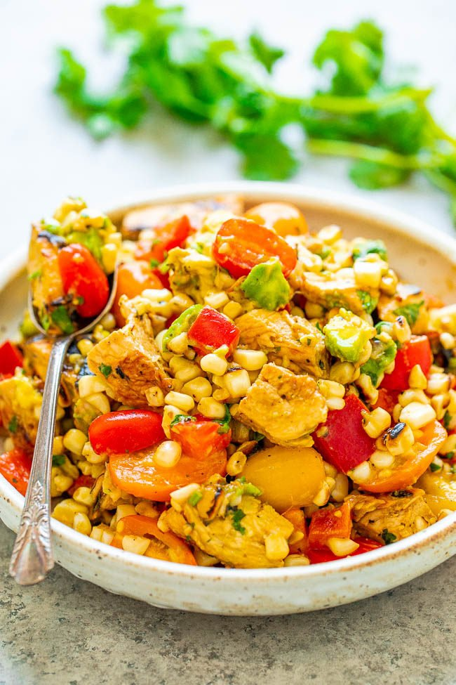 A bowl and spoon of Grilled Chicken and Corn Salad