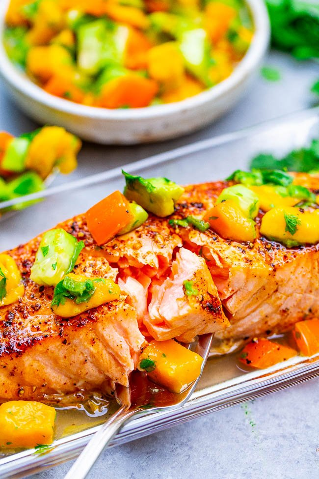 Chile Lime Salmon with Mango Avocado Salsa -  Tender and INCREDIBLE salmon with mango salsa that's bursting with Mexican FLAVORS to complement the fish!! So EASY and ready in 15 minutes!!