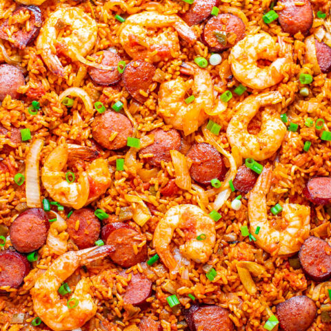 Sheet Pan Jambalaya - The EASIEST and BEST recipe for jambalaya you'll ever taste that's ready in 20 minutes!! Juicy sausage and shrimp with tender rice and the PERFECT amount of kick will keep you going back for more!!