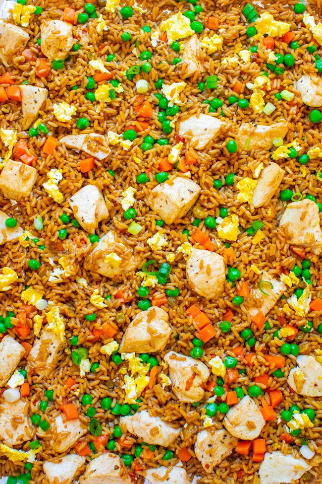"15-Minute Sheet Pan Chicken Fried Rice - Easy HEALTHIER ""fried rice"" that's actually baked and not fried!! Full of authentic flavor and ready faster than you can call for takeout!! Perfect for busy weeknights and a family FAVORITE!!"