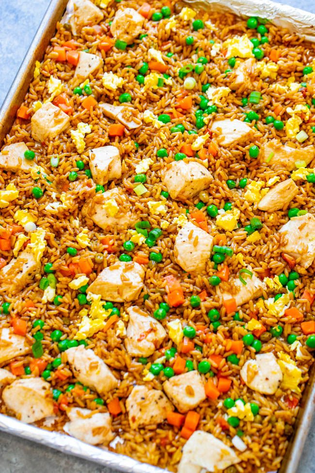 """15-Minute Sheet Pan Chicken Fried Rice - Easy HEALTHIER """"fried rice"""" that's actually baked and not fried!! Full of authentic flavor and ready faster than you can call for takeout!! Perfect for busy weeknights and a family FAVORITE!!"""
