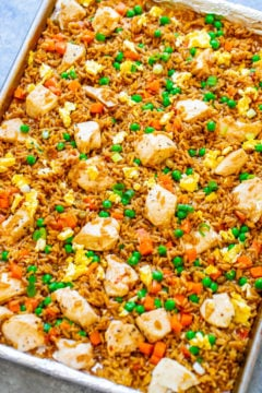 "15-Minute Sheet Pan Chicken Fried Rice – Easy HEALTHIER ""fried rice"" that's actually baked and not fried!! Full of authentic flavor and ready faster than you can call for takeout!! Perfect for busy weeknights and a family FAVORITE!!"