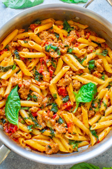 One Pot Italian Sausage and Tomato Basil Pasta - An EASY comfort food recipe that's loaded with Italian flavors, ready in 20 minutes, made in ONE pot, and a family favorite!! No need to boil the pasta separately to save time and dishes!!