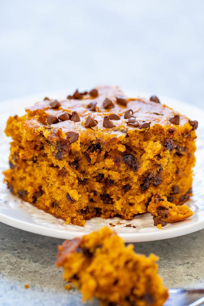 A piece of Pumpkin Chocolate Chip Cake on a white plate