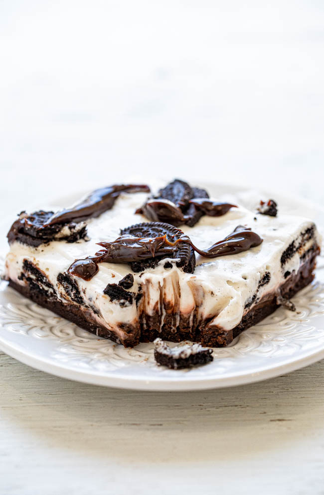 Mississippi Mud Pie Bars - An EASY, almost no-bake dessert with a chocolate chip cookie base, chocolate pudding, sweetened cream cheese, Oreos, and hot fudge!! RICH, decadent, indulgent, and a great party dessert that you can MAKE-AHEAD!!