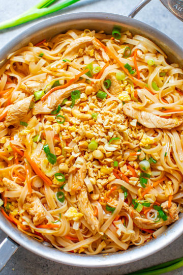 Chicken Pad Thai - EASY, ready in 20 minutes, and BETTER than takeout!! Tender rice noodles, juicy chicken, with crisp-tender carrots, cabbage, and more for an IRRESISTIBLE and AUTHENTIC chicken pad Thai!!