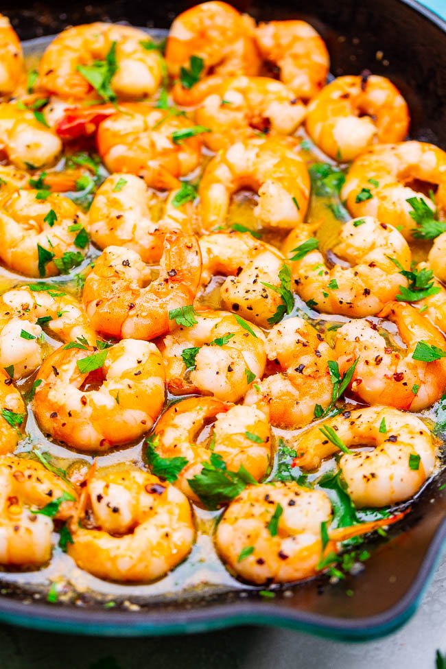 shrimp in scampi sauce in a cast iron skillet