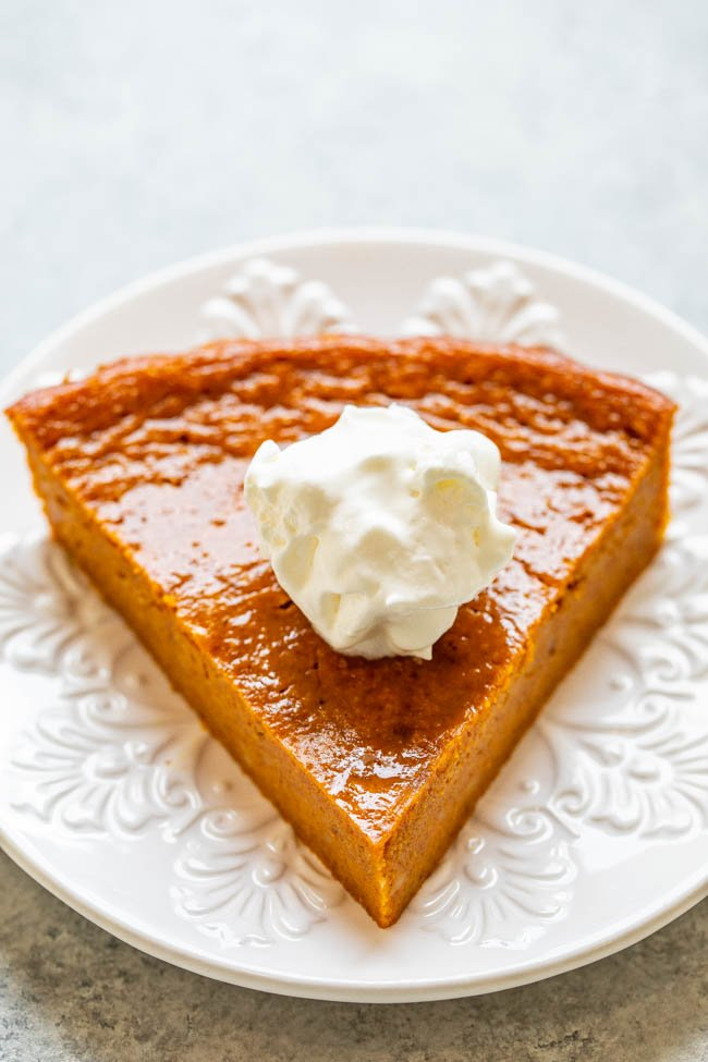 Crustless Pumpkin Pie - The EASIEST pumpkin pie you'll ever make because there's no crust!! One bowl, no mixer, and the pie is PERFECTLY flavored with plenty of pumpkin spice and everything nice! Put this pie on your holiday menu!!