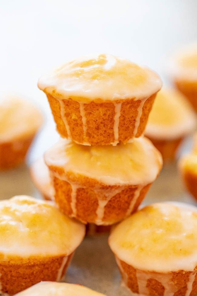 close up of a stack of glazed champagne orange muffins