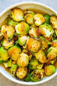 Orange Glazed Brussels Sprouts - A FAST and EASY side dish that jazzes up Brussels sprouts with a citrus twist!! Great for fall and winter holiday entertaining or as HEALTHY weeknight side!!