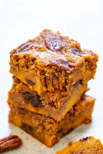 Soft Pumpkin Praline Bars - SUPER soft pumpkin bars studded with chocolate chips, candied pecans, and plenty of pumpkin pie spice!! A FAST and EASY dessert that feeds a crowd for your fall and winter celebrations!!