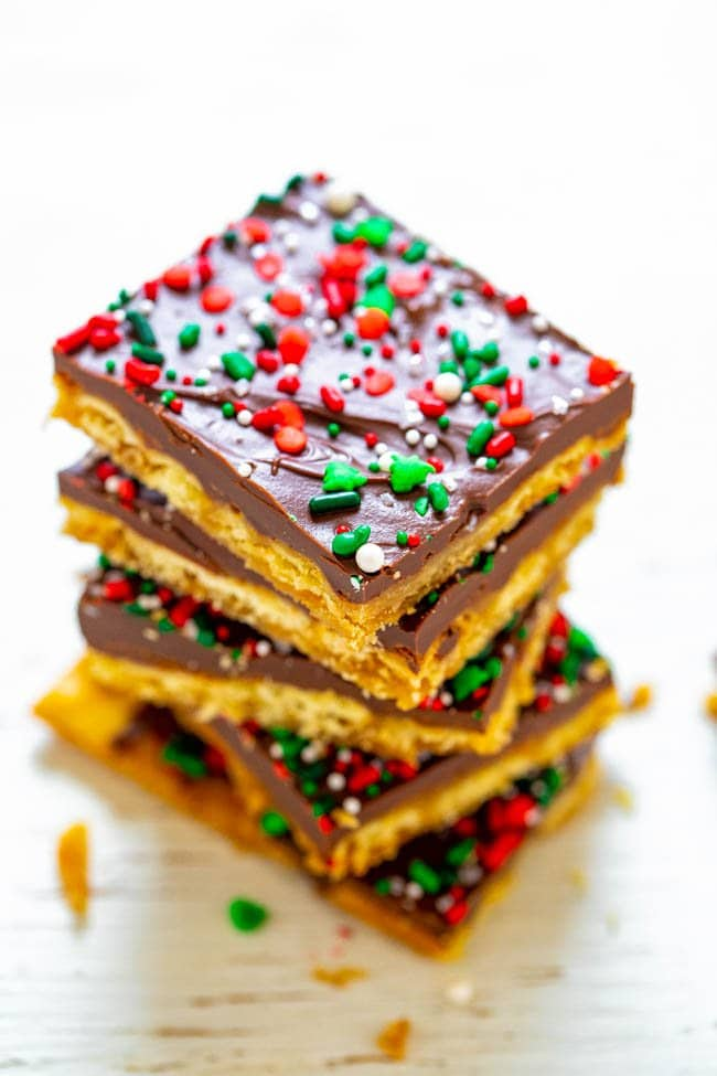 squares of Christmas crack toffee in a stack