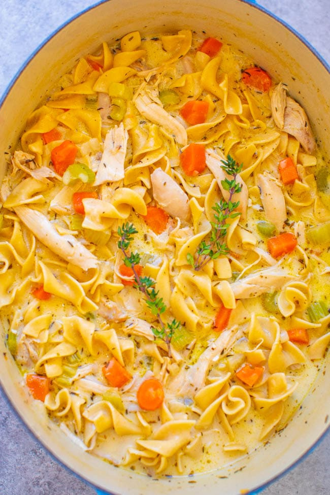 overhead view of creamy chicken noodle soup in a large dutch oven
