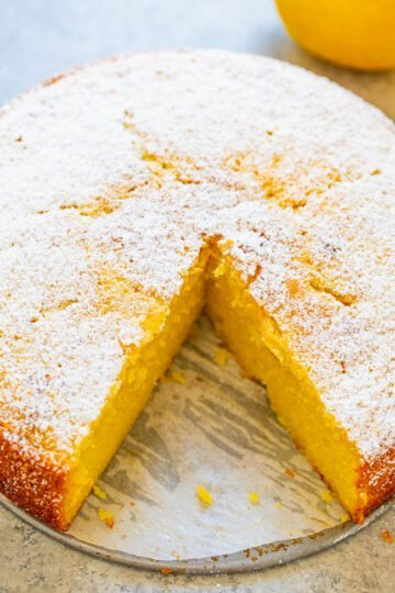Lemon Olive Oil Cake - My new FAVORITE lemon dessert of all time!! Lemon zest, juice, extract, and Limoncello add so much AMAZING lemon flavor to this EASY, ridiculously moist no-mixer cake that's unique and INCREDIBLE!!