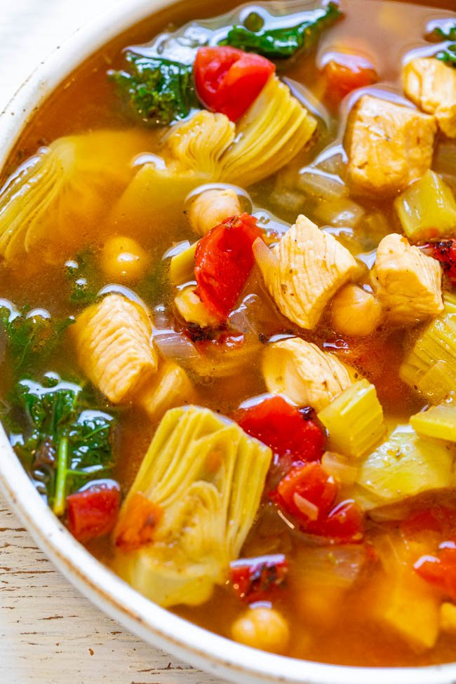 close up of a bowl of Mediterranean vegetable soup with chicken in it