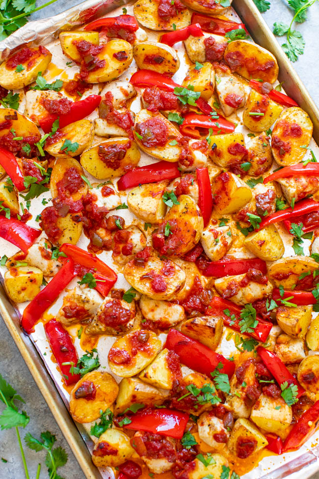 sheet pan chicken and potatoes coated with salsa