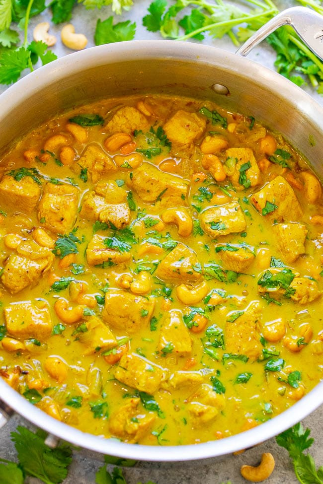 Yellow Chicken Coconut Curry (Chicken Korma) - An EASY Indian recipe you can make at home in 25 minutes that tastes like it's from a restaurant!! Chicken, cashews, and spices are simmered in coconut milk for the WIN!!