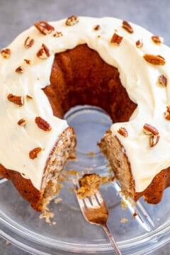 Hummingbird Cake - A super SOFT and moist cake with bananas, pineapple, coconut, cream cheese frosting, and pecans!! Makes a huge cake that'll feed a crowd! If you like banana bread, you will LOVE this cake! Put this EASY retro gem on your baking list!!