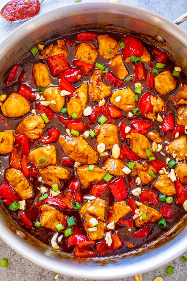overhead view of kung pao chicken in a metal skillet