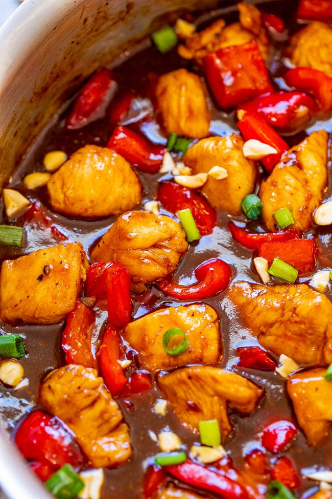 close up of chicken swimming in kung pao sauce