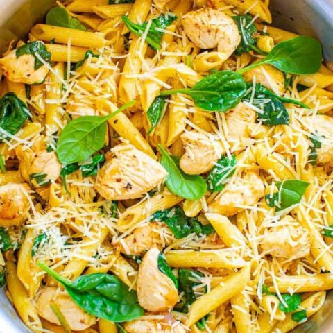 Parmesan Chicken and Spinach Pasta - EASY and ready in 20 minutes with comforting pasta, juicy chicken, a hint of lemon, and the PERFECT amount of Parmesan!! Great for busy weeknights and the extra is good for meal prepping!!
