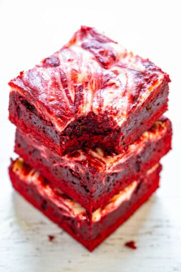 Red Velvet Cheesecake Brownies - Rich, decadent, red velvet brownies topped with tangy cream cheese swirls!! PERFECT for Valentine's Day, the Christmas season, or anytime you're craving red velvet! EASIER than you think to make!!