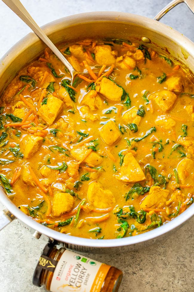 Yellow Thai Chicken Coconut Curry In pan with spoon