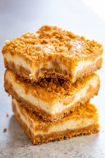 Butterscotch Graham Cracker Cheesecake Bars - A super chewy crust made with butterscotch chips and graham cracker crumbs that also doubles as the topping!! The silky smooth tangy cheesecake layer is the PERFECT contrast! A simple recipe that FAR EXCEEDED expectations!!