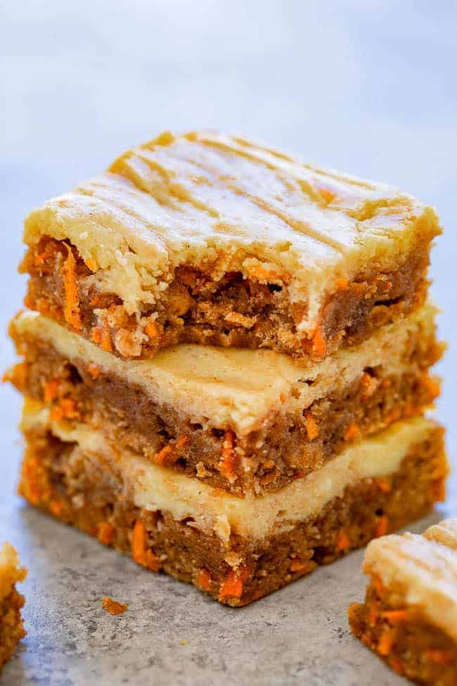 Carrot Cake Cream Cheese Blondies - Dense, chewy, super moist bars that taste like carrot cake with a cream cheese topping that's baked right in so you don't need to worry about frosting them!! So much EASIER than making carrot cake but with similar flavors you will LOVE!!
