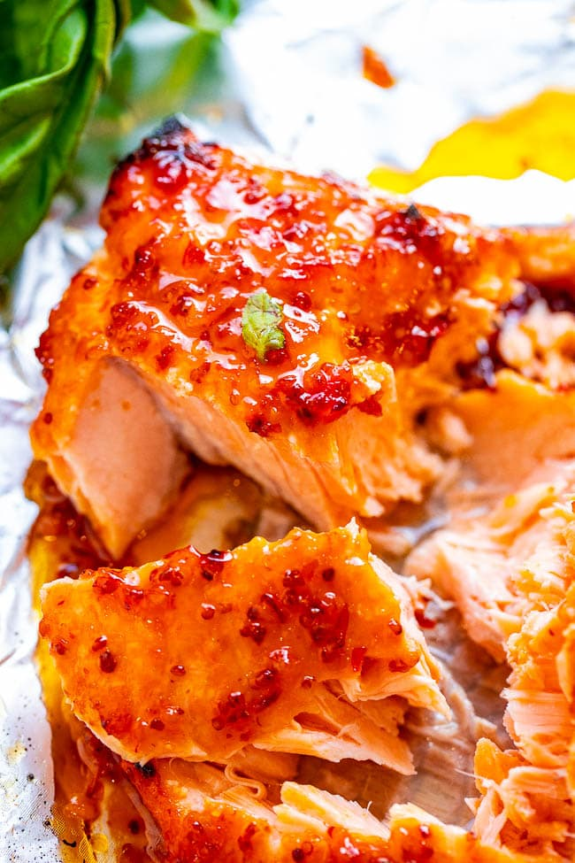 Sheet Pan Chili Dijon Salmon - A 5-ingredient salmon recipe that tastes 5-STARS and is ready in 25 minutes!! Loaded with layers of incredible flavor from two types of chili sauce, Dijon mustard, and honey! You'll LOVE this salmon recipe!!