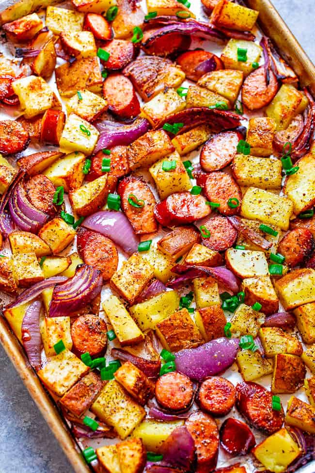 Sheet Pan Sausage And Potatoes  - This EASY sheet pan sausage dinner with just 5 ingredients can be made with your pre-cooked sausage of choice and is ready in 45 minutes!! Hearty comfort food with tons of FLAVOR and the recipe is super customizable!!