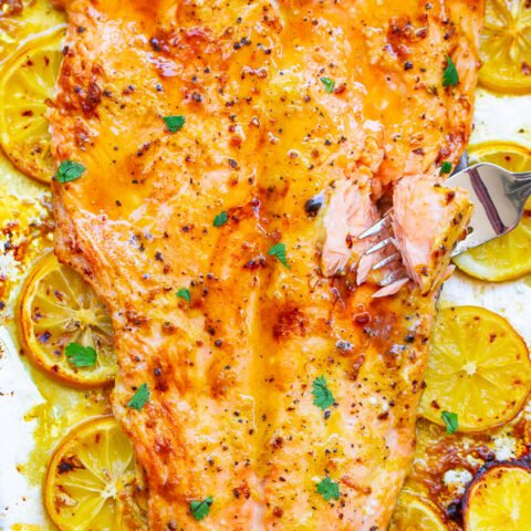 Lemon Pepper Dijon Salmon - Juicy baked salmon at home in 20 minutes that's so EASY and tastes BETTER than from a fancy restaurant!! The lemons, lemon pepper, and Dijon add so much rich FLAVOR to this FOOLPROOF sheet pan salmon!!