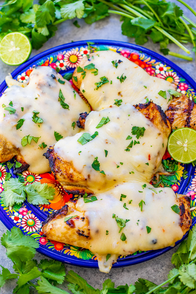 Grilled Salsa Verde Pepper Jack Chicken - The EASIEST salsa verde marinade keeps this chicken so juicy and tender!! Melted pepper Jack cheese on top takes an already awesome piece of chicken and makes it that much BETTER!!