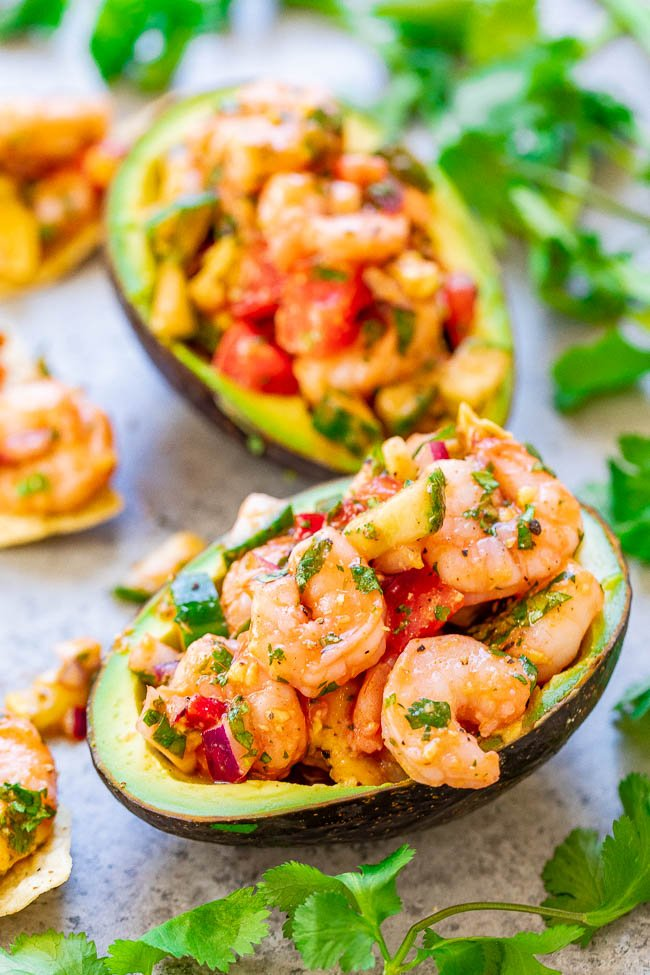 Shrimp Stuffed Avocados - If you like ceviche, you're going to LOVE these EASY avocados stuffed with a mixture of shrimp, tomatoes, cucumber, red onions, and more - plus some hot sauce for a touch of heat!! There's a time-saving shortcut so these are ready in 15 minutes with no fuss!!